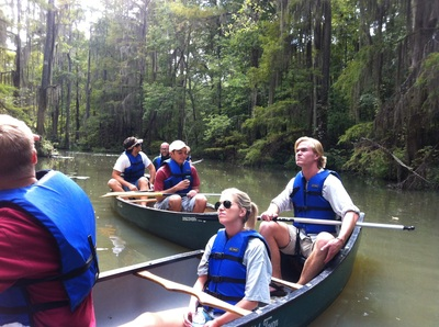 a group of students in canoes