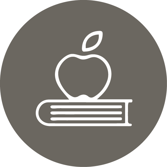 an apple on top of a book